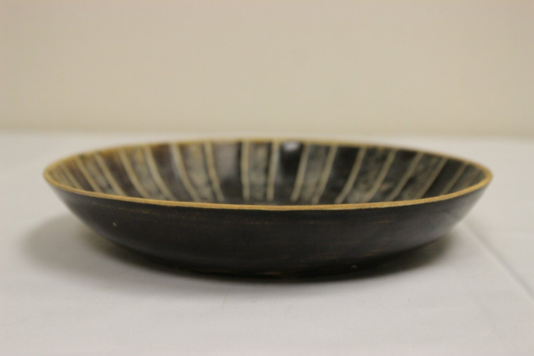 Song style brown glazed dish with floral decoration