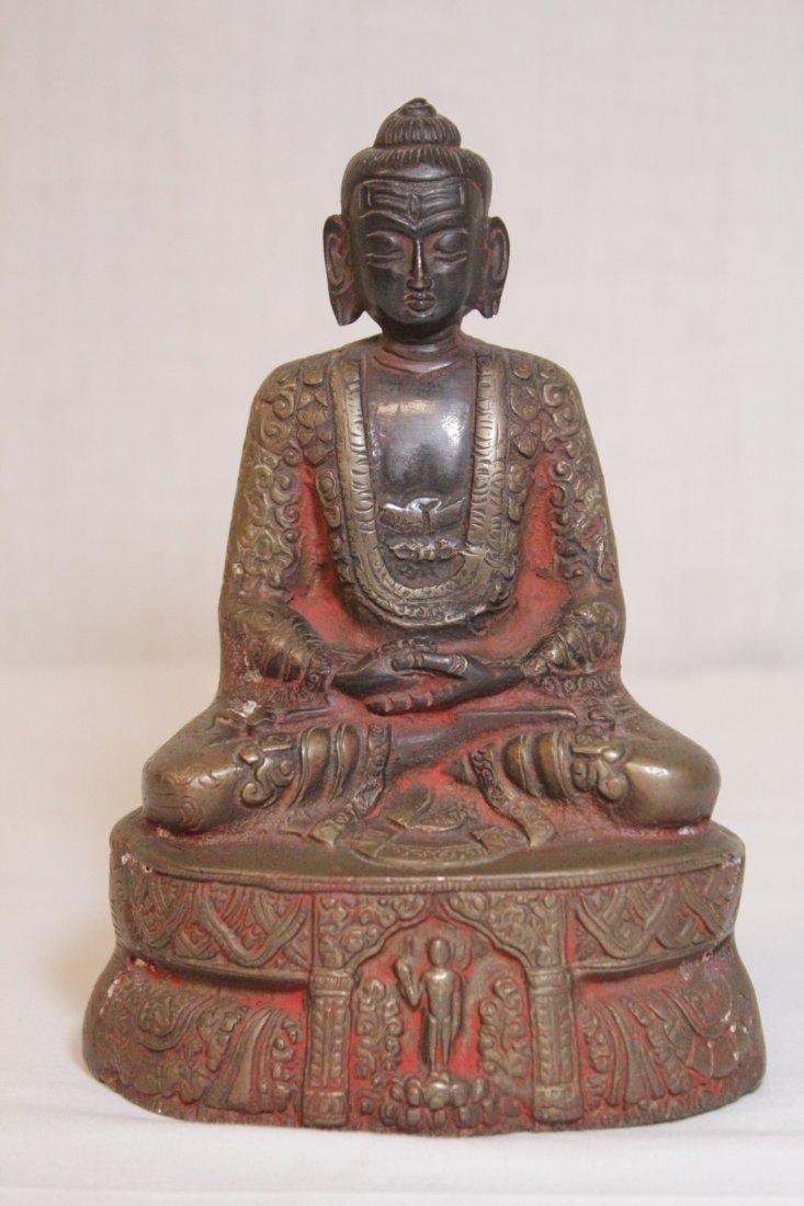 Bronze sculpture of seated Buddha