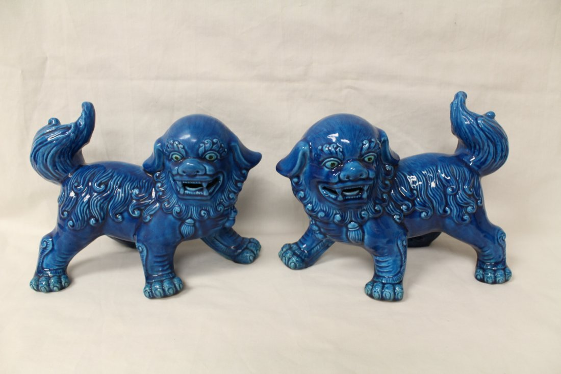 Pair Chinese blue glazed fulion
