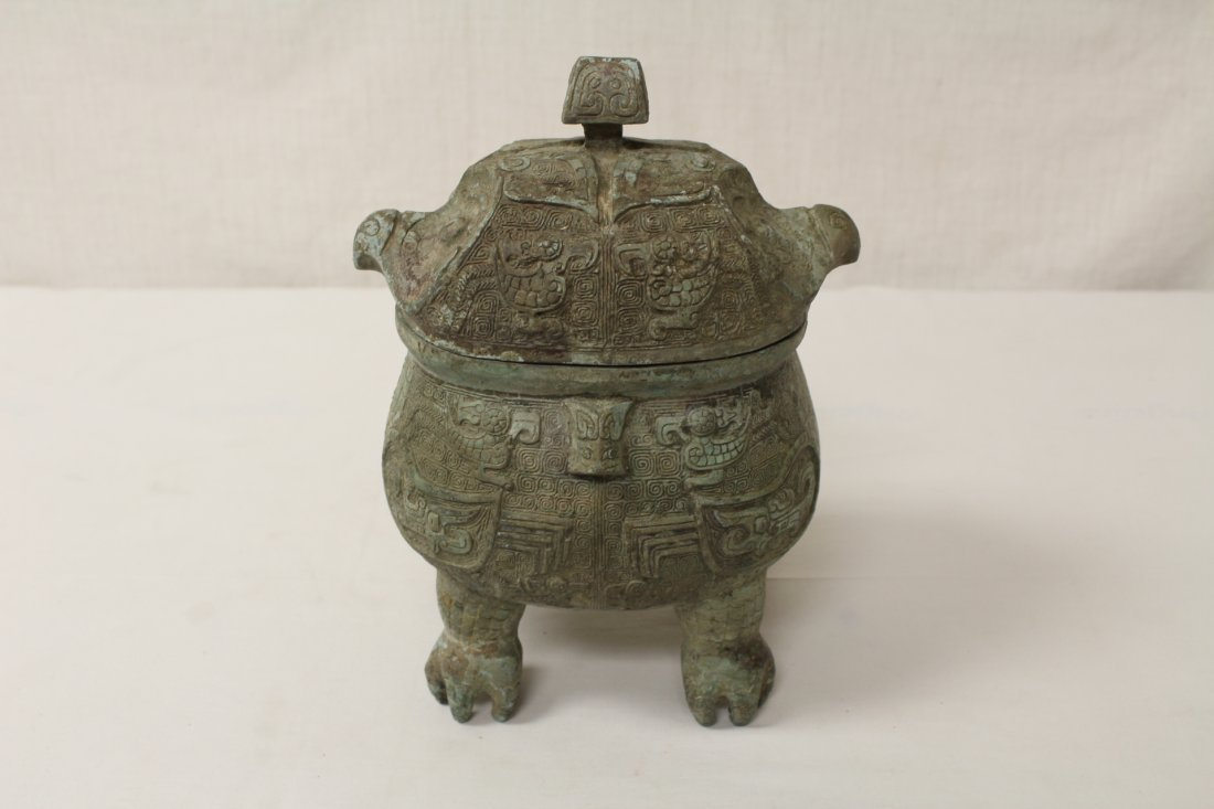 Chinese bronze covered ding in the form of bird