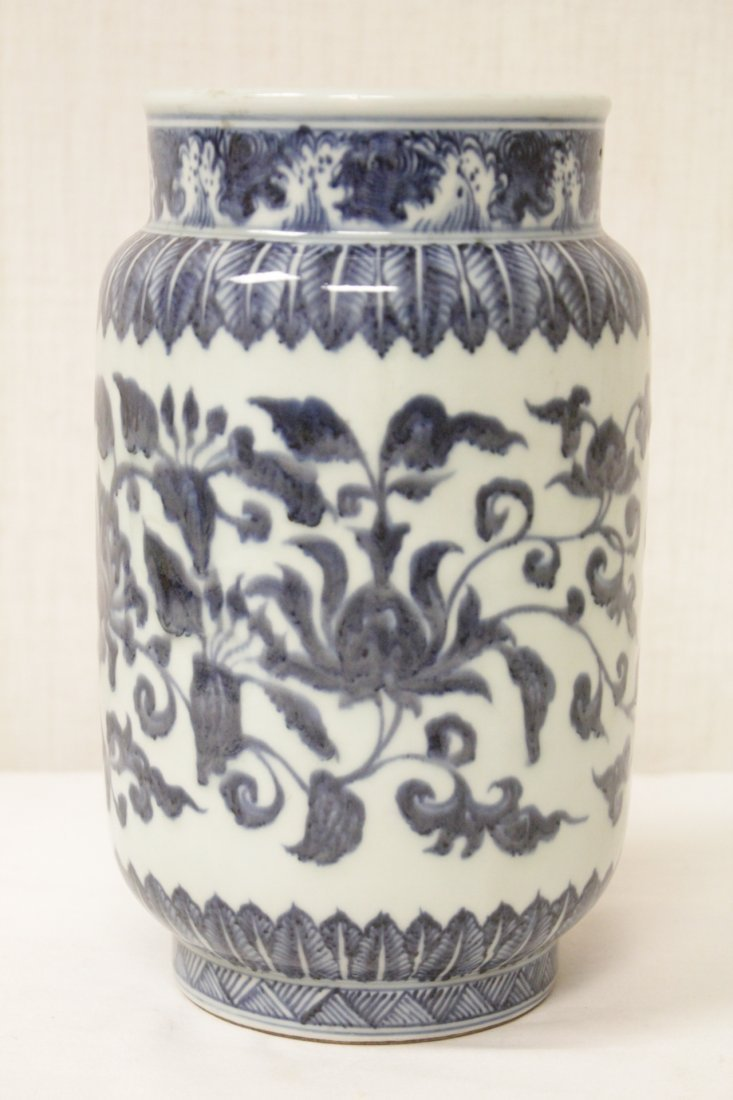 A vintage Chinese blue and white straight vase