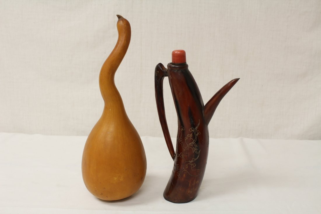 A horn carved teapot and a gourd