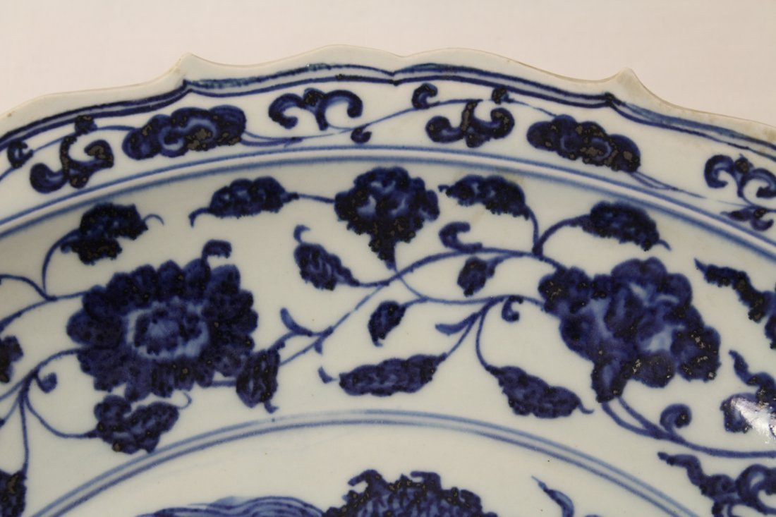 A large Chinese blue and white porcelain charger - 5