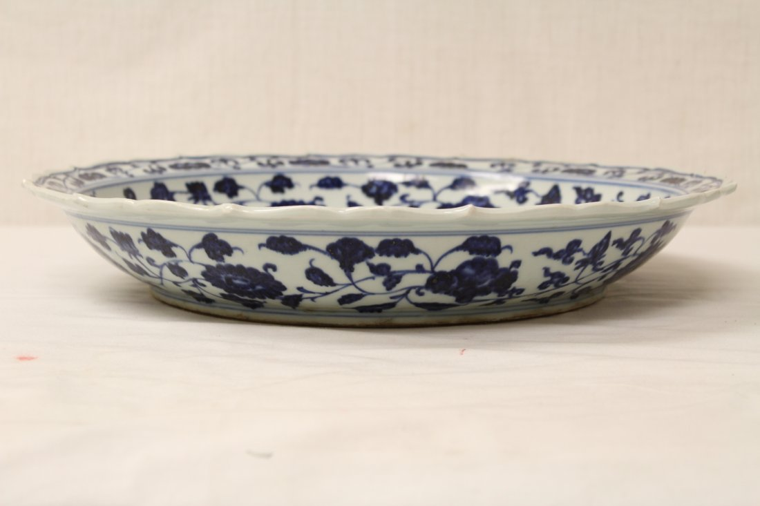 A large Chinese blue and white porcelain charger - 6