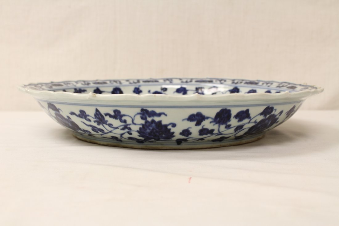 A large Chinese blue and white porcelain charger - 7