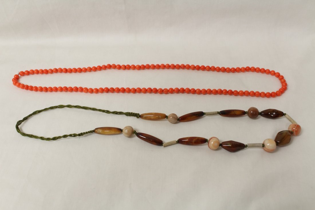 2 necklaces; agate bead and coral like bead