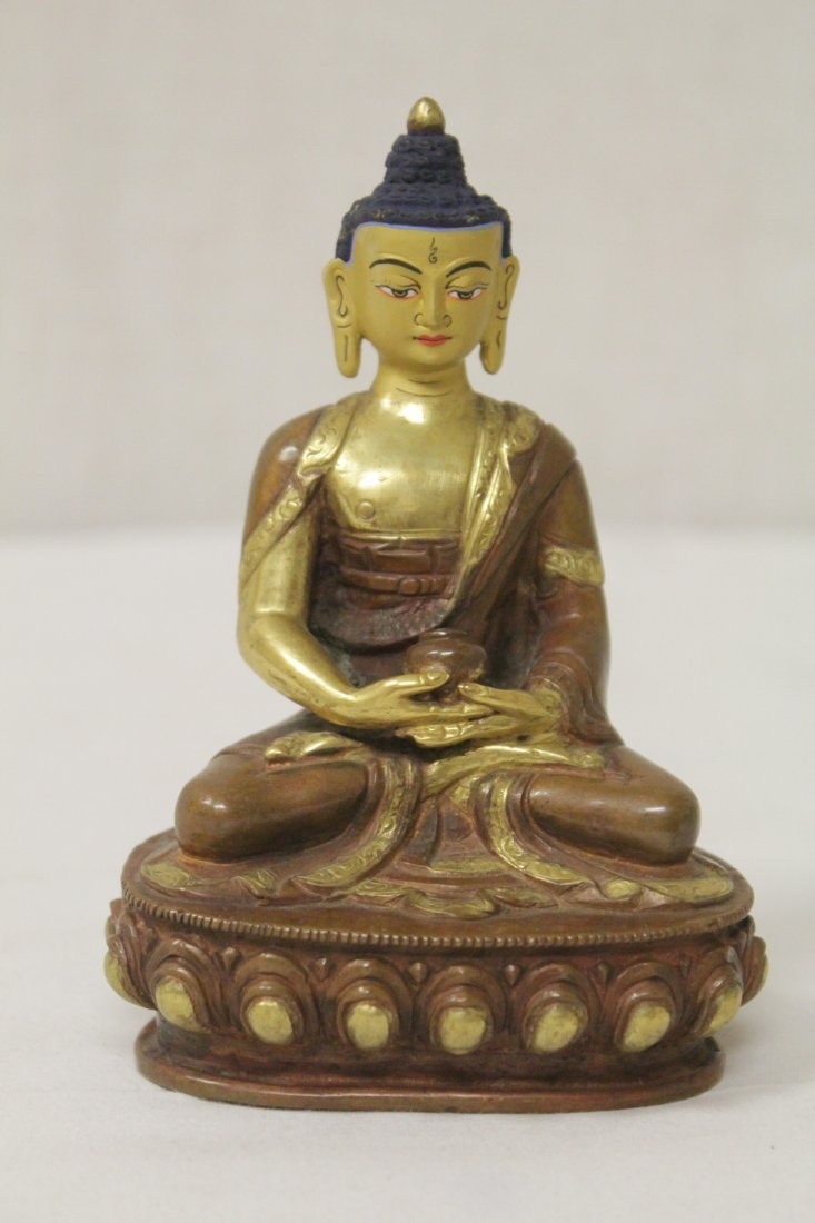 A small gilt bronze seated Buddha