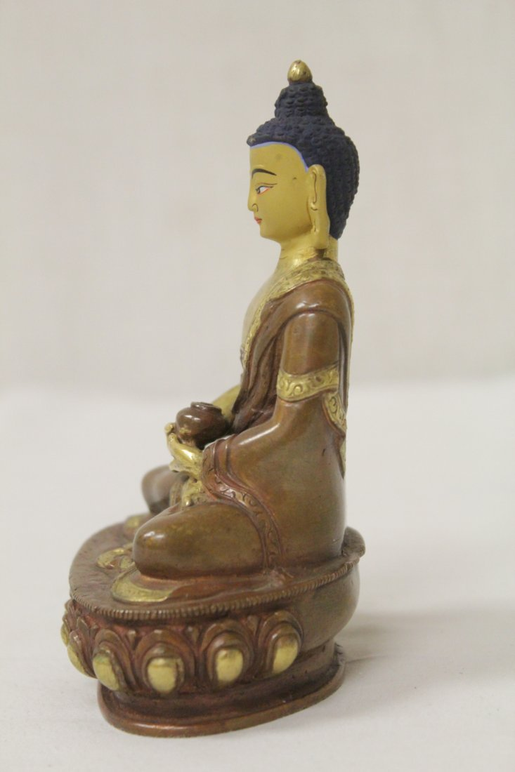 A small gilt bronze seated Buddha - 3