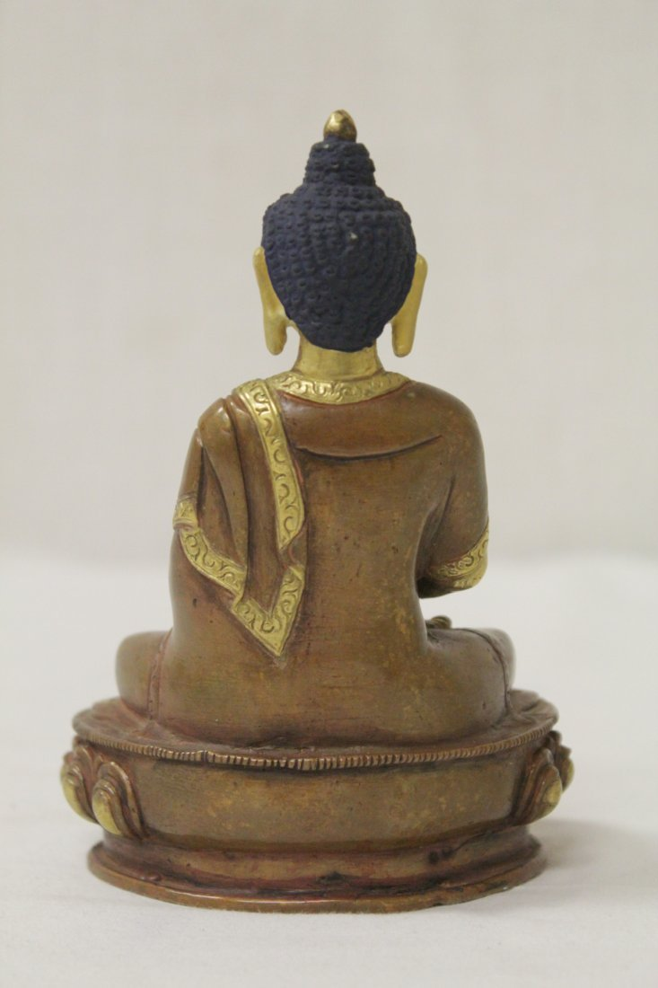 A small gilt bronze seated Buddha - 4