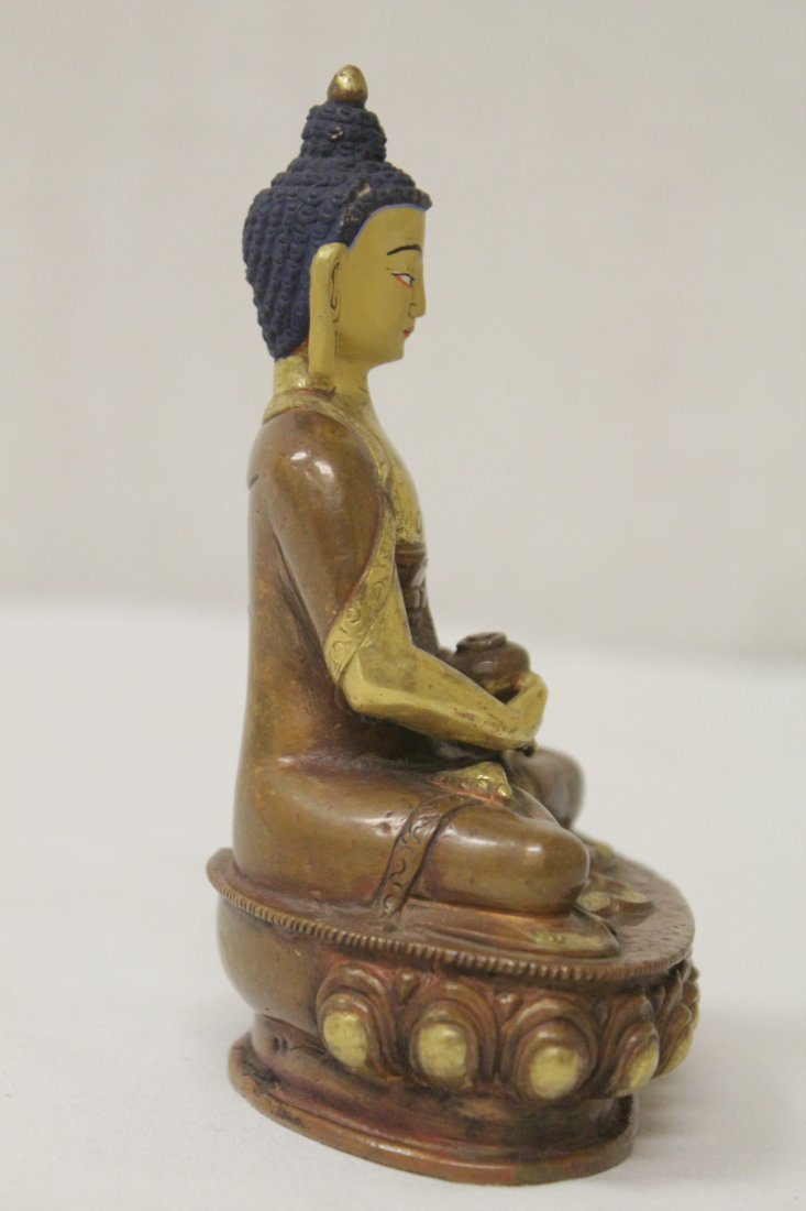 A small gilt bronze seated Buddha - 5