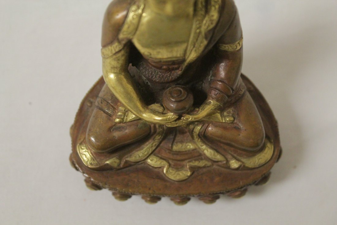 A small gilt bronze seated Buddha - 7