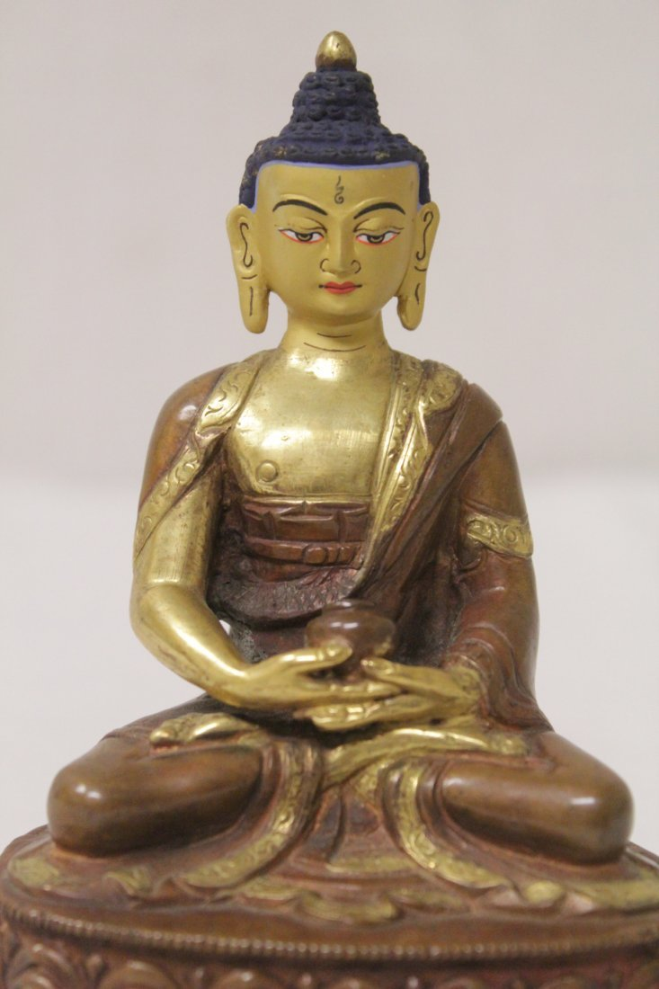 A small gilt bronze seated Buddha - 8