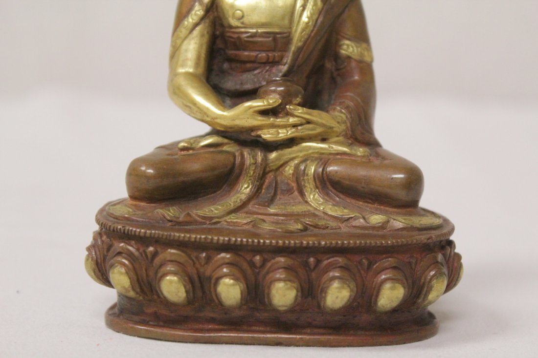 A small gilt bronze seated Buddha - 9