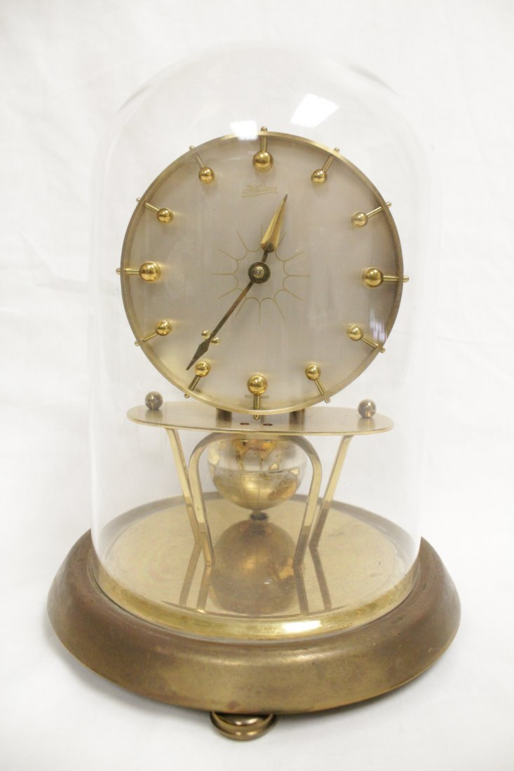 Unusual dome clock by Kaiser with globe