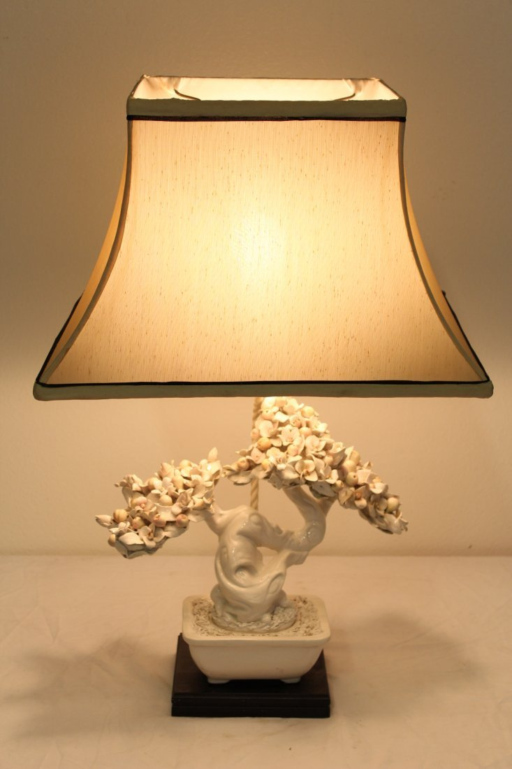 A table lamp with white porcelain fruit tree
