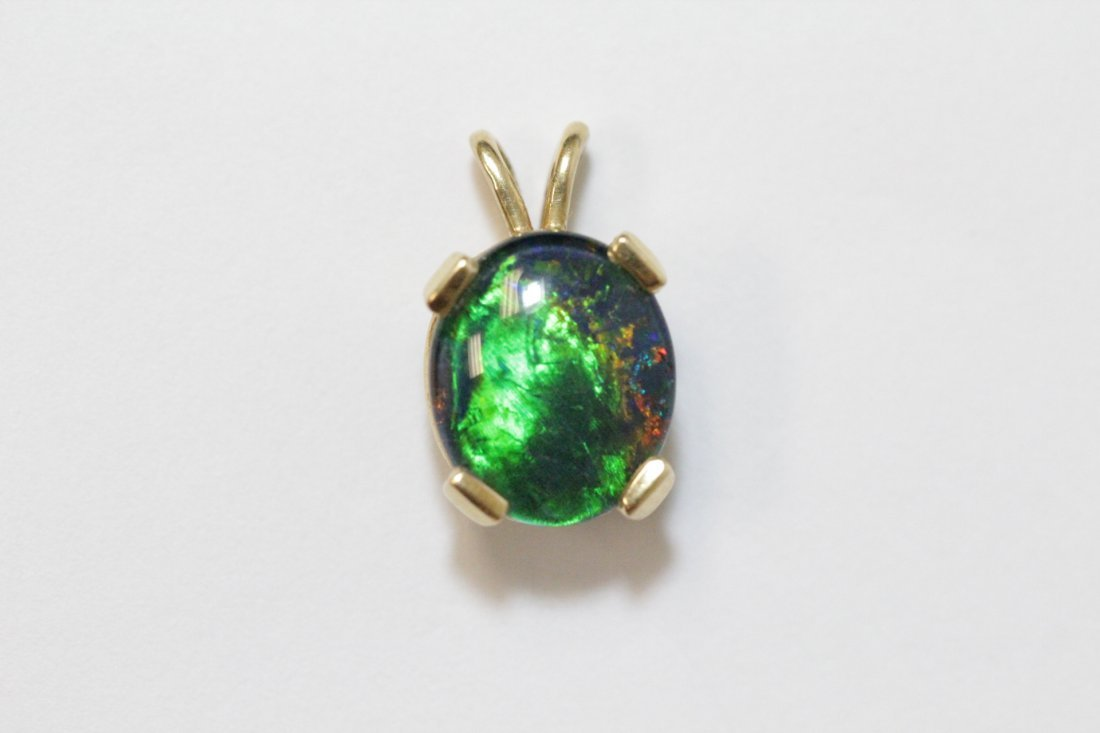 Two 14K Y/G pendant set with synthetic opals - 7