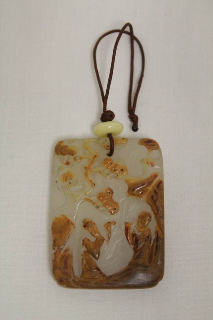 A fine Chinese white jade carved plaque