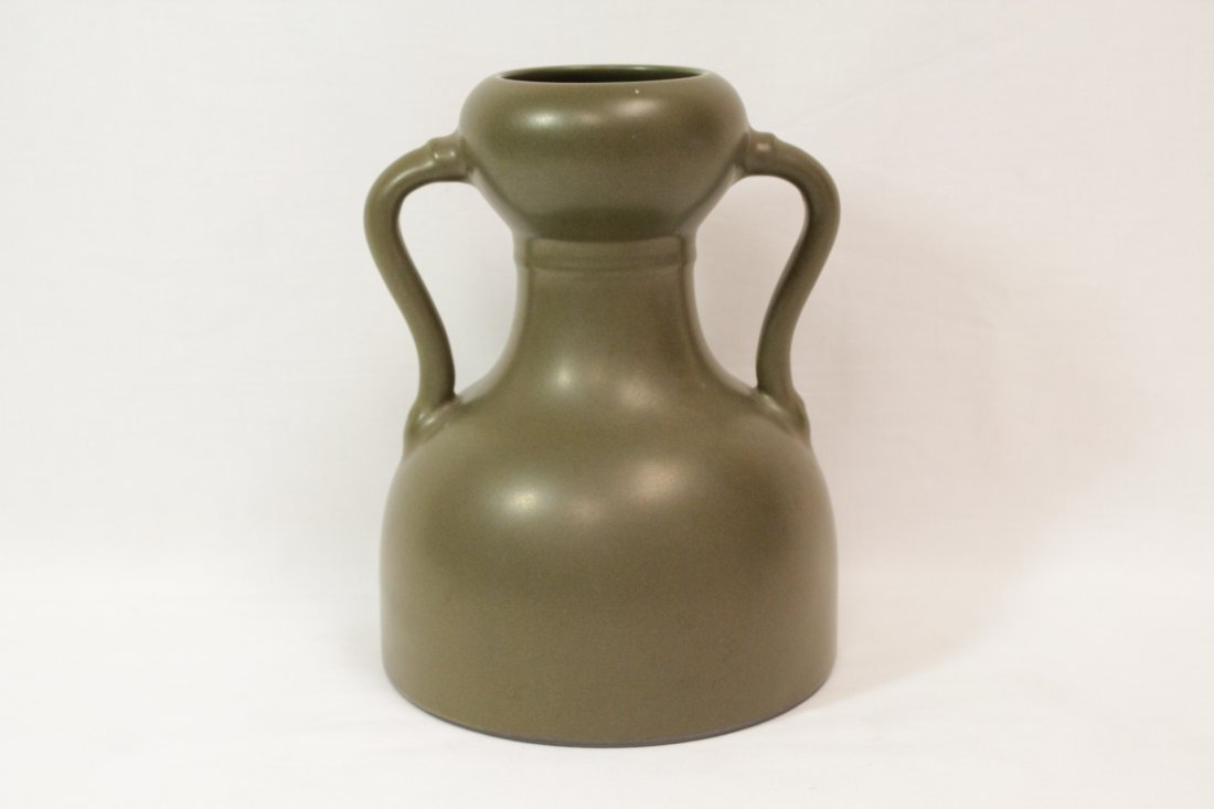 A tea glazed handled porcelain vase
