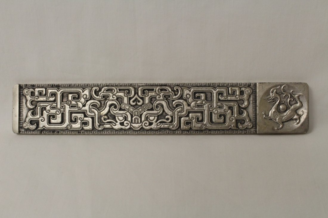 Chinese silver on bronze scroll weight