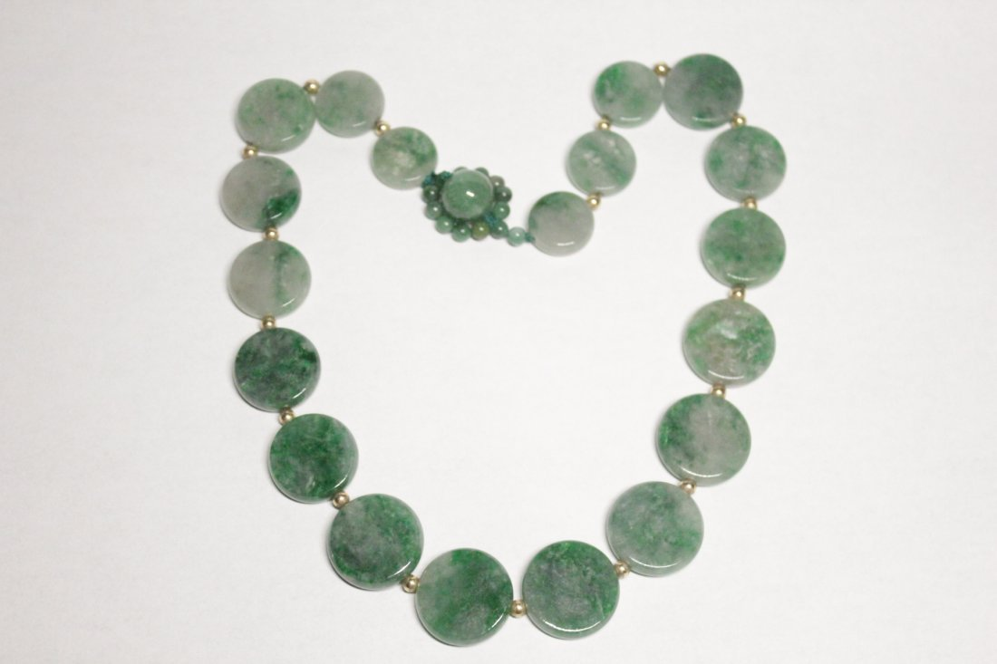 Necklace with round jadeite plaques
