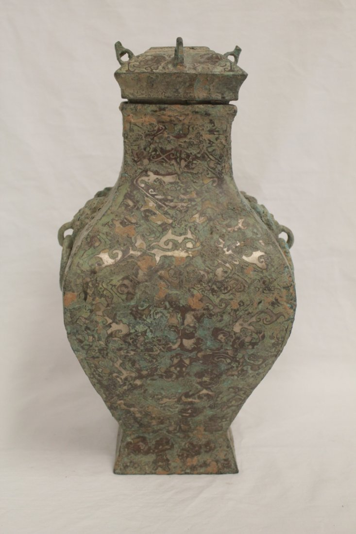 Chinese bronze wine jar with silver like inlaid