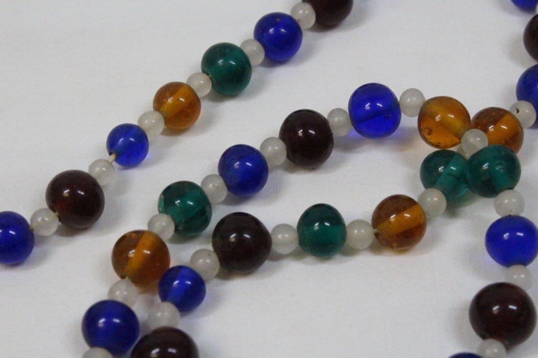 3 loose necklaces - 9