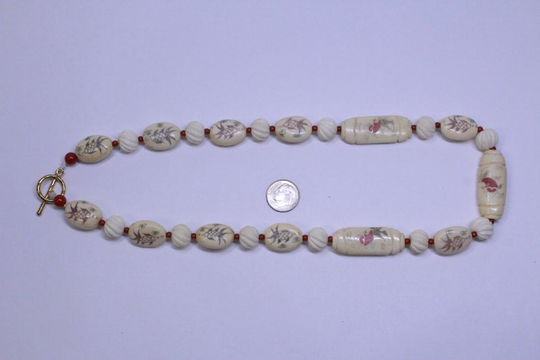 A bone carved bead necklace