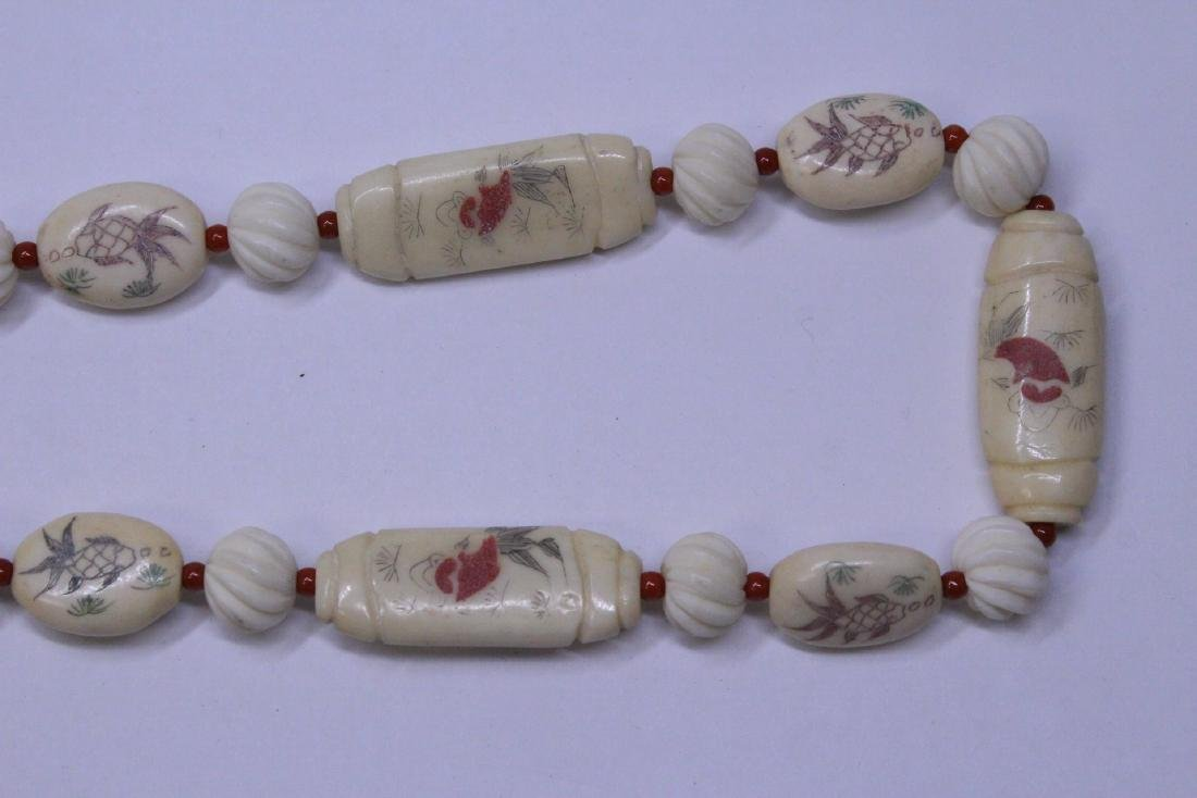 A bone carved bead necklace - 4