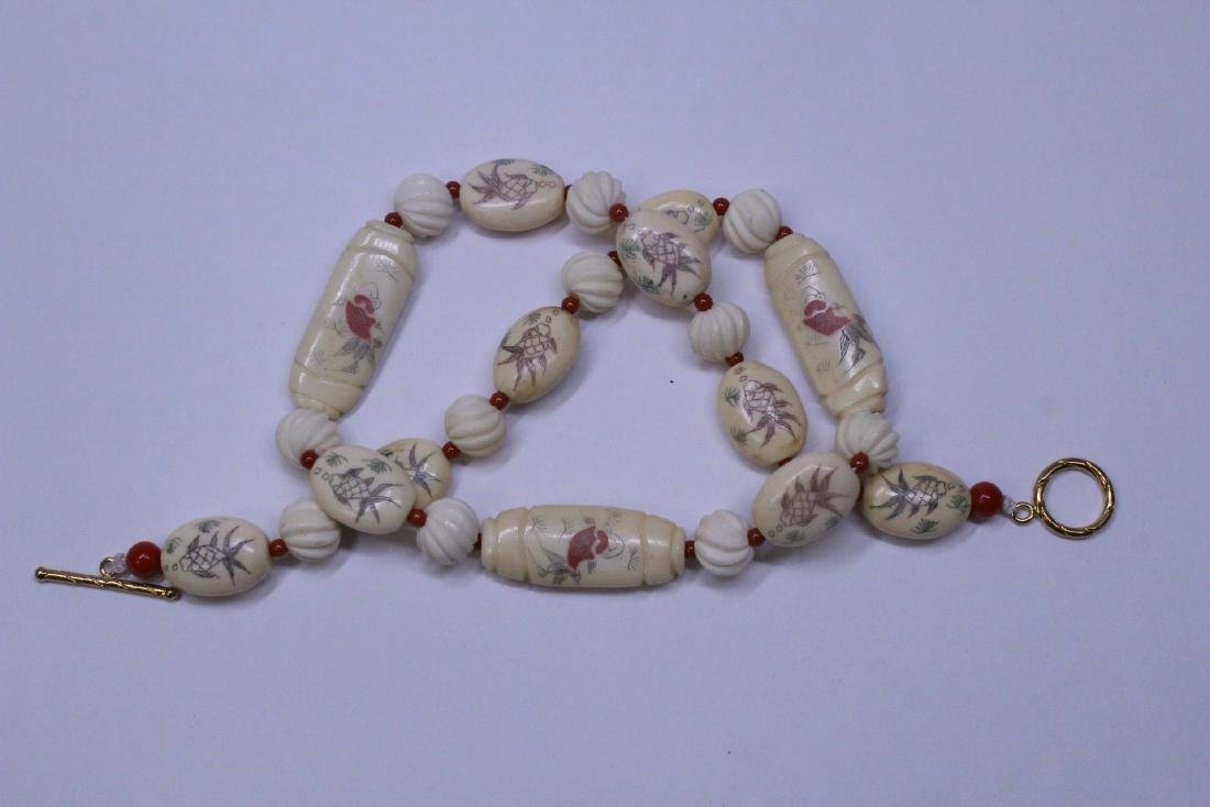 A bone carved bead necklace - 9