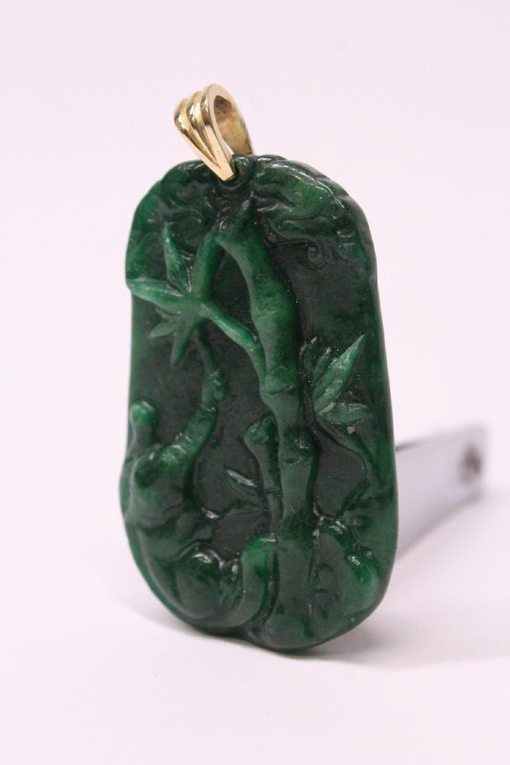 An emerald green jadeite pendant w/ 14K clasp - 10