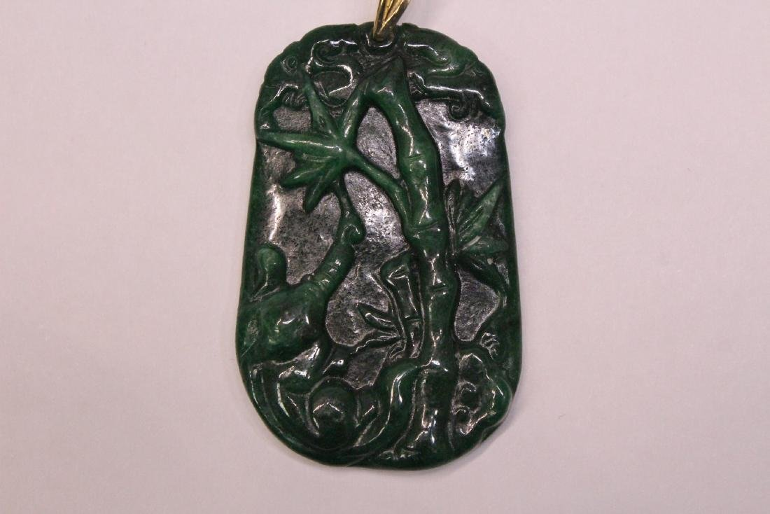 An emerald green jadeite pendant w/ 14K clasp - 3