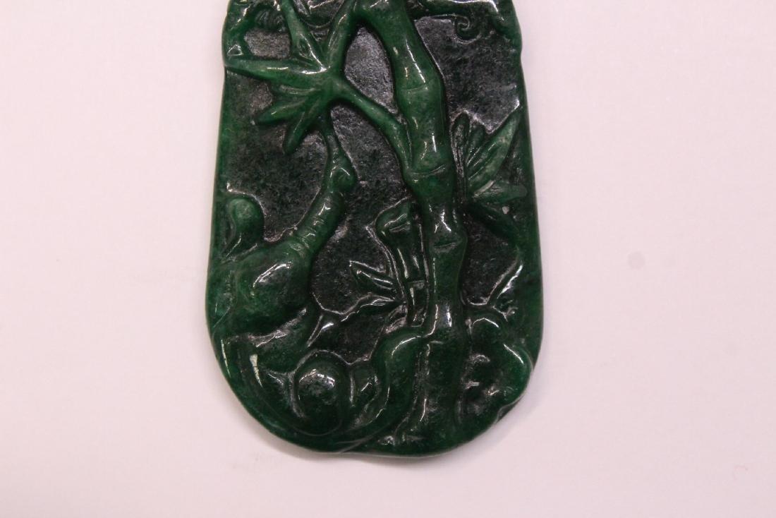 An emerald green jadeite pendant w/ 14K clasp - 4