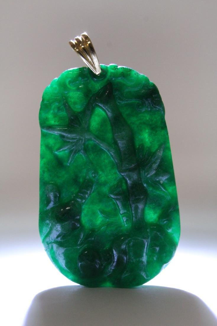 An emerald green jadeite pendant w/ 14K clasp - 8
