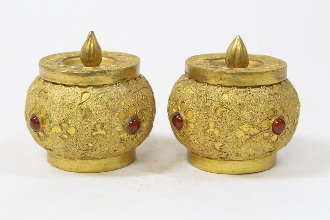 Pair gilt covered boxes