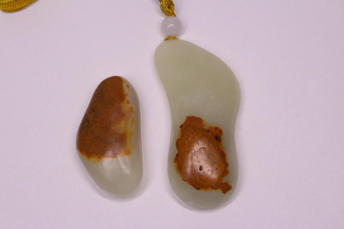 2 light celadon pebble jade ornaments