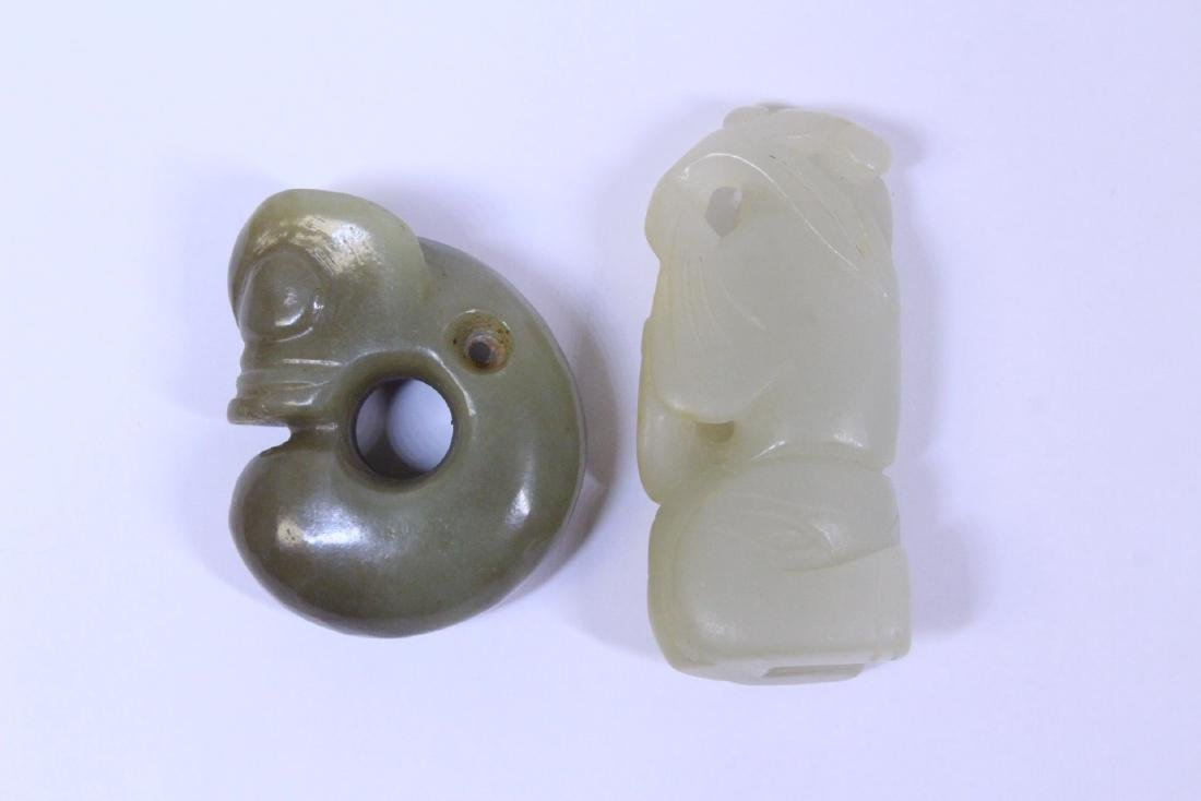2 jade carved ornament, one in figure motif - 2