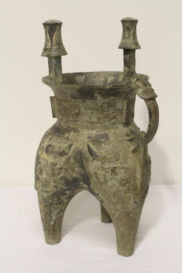 A large Chinese bronze tripod food vessel - 6