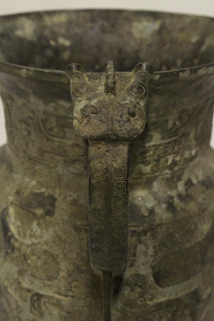 A large Chinese bronze tripod food vessel - 7
