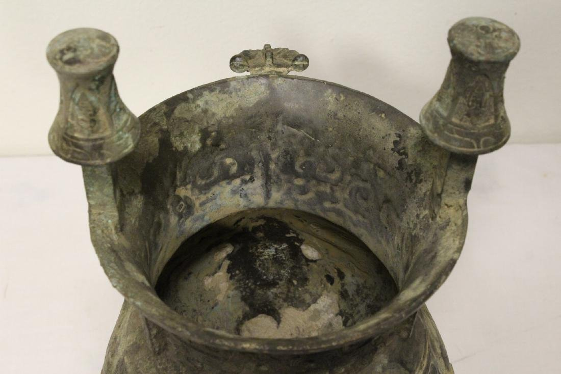 A large Chinese bronze tripod food vessel - 9