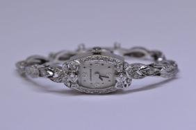 14K W/G diamond wrist watch by Longines