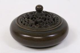 A very heavy small bronze covered censer