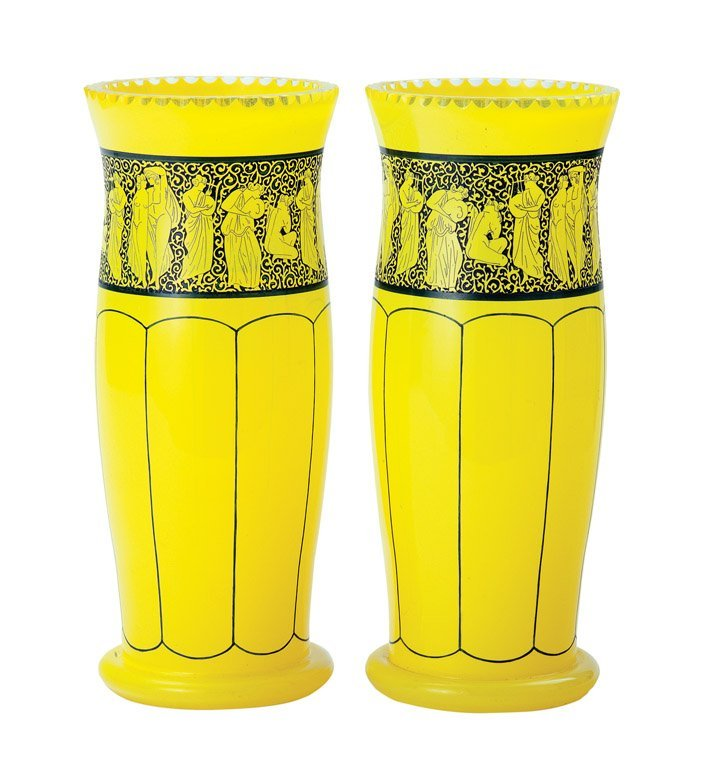 23: A fine pair of yellow glass and black enamel and ca