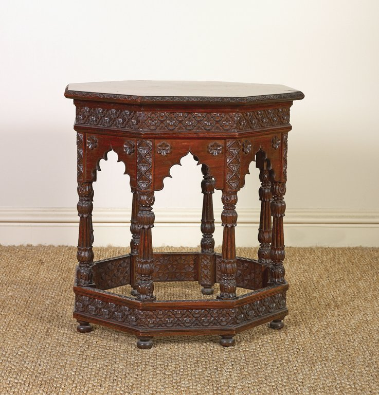 22: An exceptional carved side table, of hexagonal form