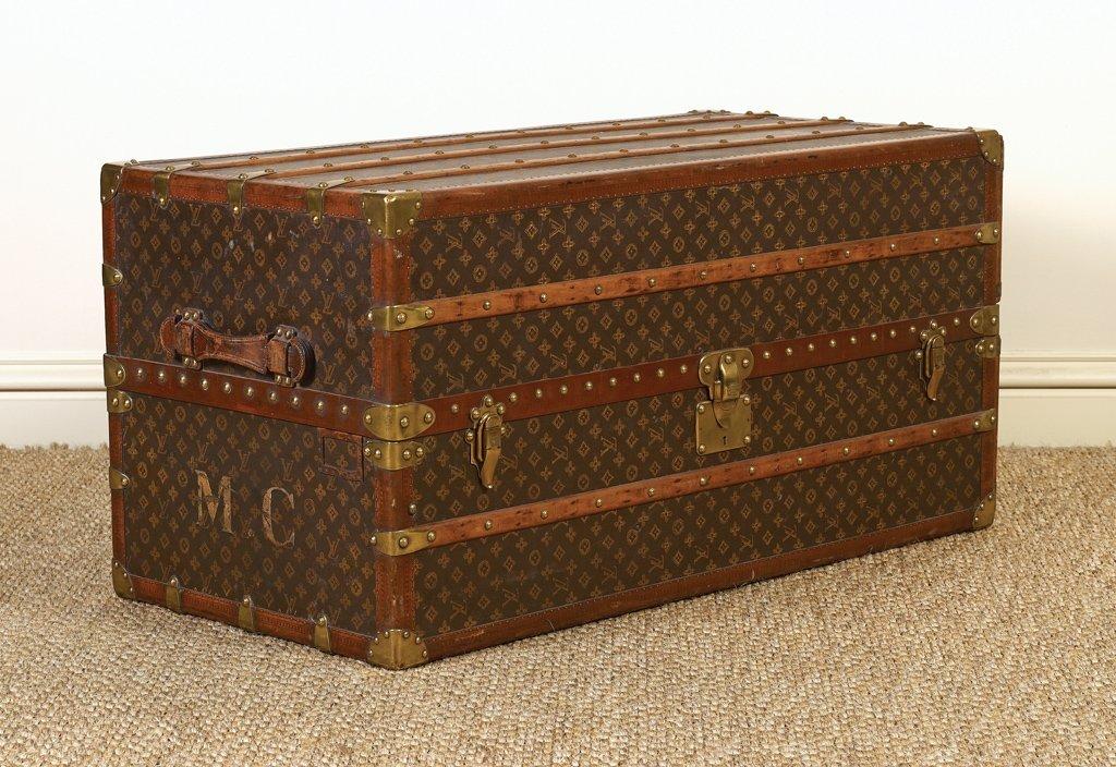 24: A Louis Vuitton Malle-armoire (Wardrobe), French ci
