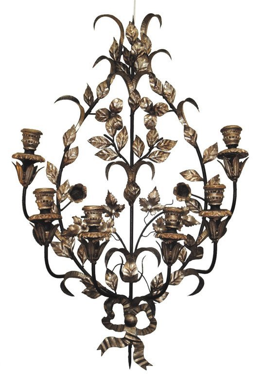 9: A pair of black and silver gilt foliate candle wall