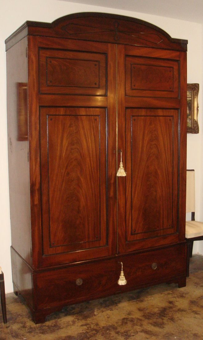 18: A fine Regency mahogany wardrobe with ebony stringi