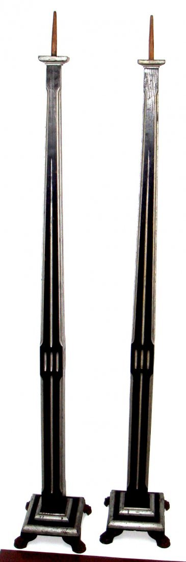 24: A pair of Art Deco tall black and silver candlestic