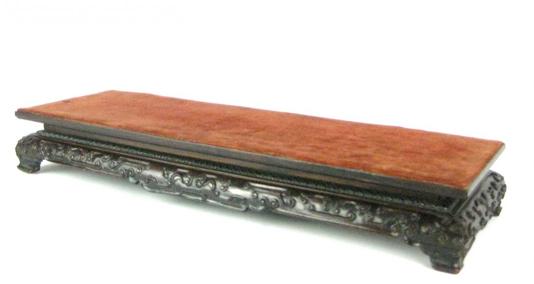 21: A Chinese rectangular hardwood stand, late Qing dyn
