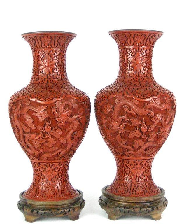 22: A large pair of Chinese cinnabar lacquer Yanyan vas