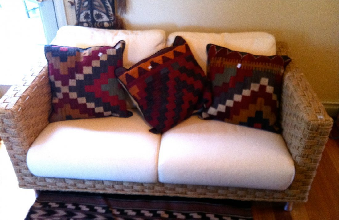 22: A woven rush two-seater settee 65cm high, 148cm wid